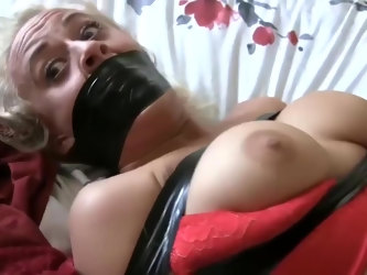 Mature blonde woman likes to get tied up and forced to cum by a stranger