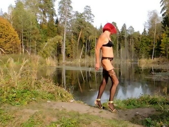I'm walking along the pond in high heels and stockings