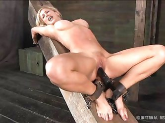 There's nothing more beautiful then seeing a big boobs blonde tied up and with her pussy stuffed. This luscious blonde is receiving all the pain,