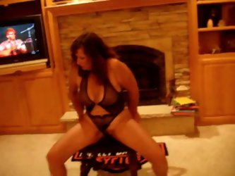 Home made video of my mature brunette-haired wife in lingerie riding her big expensive toy until she moans with delight as she has a hot orgasm.