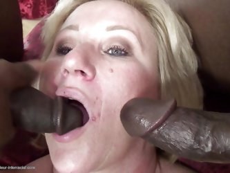 Molly loves to fill her mouth with cocks, especially big black hard ones! Here she is down on her knees with two dicks on her left and right and she c