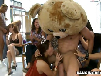 They are all enjoying themselves as the bear head puts his huge dick into the mouths of the attendants as each of the woman present try to put more ef