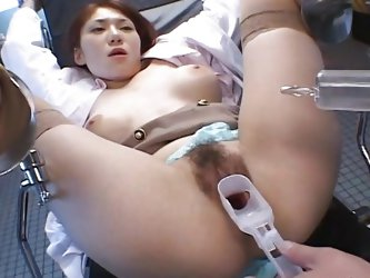Cute Runa is tied on the gynecologist table. She's immobilized with her thighs spread wide and the guy begins to play with her pussy. He pulls ov