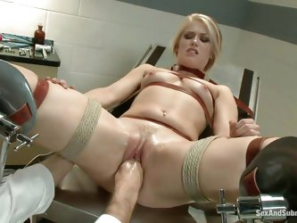 It's a hard exam for Ash's pussy, she's tied with red leather belts on the gynecologist table and her doc performs a hard fisting befor