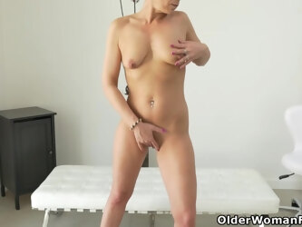 Skinny mature Sunny works her lubed pussy with big dildo