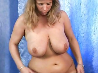 This sexy blonde women is in her bedroom wearing sexy lingerie and pantyhose. Now she takes off her lingerie and she shows a pair of round big boobs p
