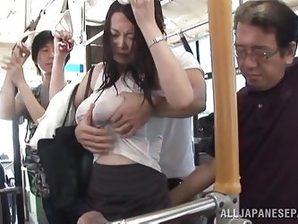 It was a hot day and the busty Nippon milf hurried to catch the bus. She was sweaty and through that transparent blouse her luscious form were clear.