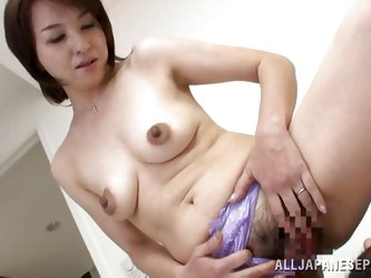 Kumi has a pair of cute titties and some very perky nipples. The mature Nippon slut needs to fuck and the thought of dick makes not only her nipples p