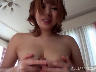 Japanese babe gives a titjob with her natural breasts and rides
